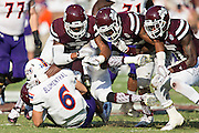 STARKVILLE, MS - SEPTEMBER 19:  Joel Blumenthal #6 of the Northwestern State Demons is tackled by four defensive players of the Mississippi State Bulldogs at Davis Wade Stadium on September 19, 2015 in Starkville, Mississippi.  The Bulldogs defeated the Demons 62-13.  (Photo by Wesley Hitt/Getty Images) *** Local Caption *** Joel Blumenthal