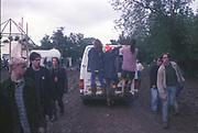 Ravers hanging onto the back of a van. Glastonbury, 1992.