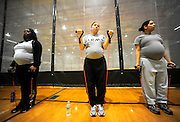 Sgt. Charlese Jones, l-r, Pvt. 1st Class Allyssa Carrizales, and Sgt. Anaydeth Torres stretch during an aerobic circuit workout Feb. 5. All expecting and postpartum Soldiers participate in the Army Pregnancy Postpartum Physical Training Program that features four days of exercise and one of related classes..