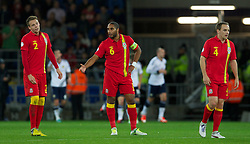 12.10.2012, Cardiff City Stadium, Cardiff, WAL, FIFA WM Qualifikation, Wales vs Schottland, im Bild Wales' captain Ashley Williams and Chris Gunter look dejected as Scotland score the opening goal during FIFA World Cup Qualifier Match between Wales and Scotland at the Cardiff City Stadium, Cardiff, Wales on 2012/10/12. EXPA Pictures © 2012, PhotoCredit: EXPA/ Propagandaphoto/ David Rawcliffe..***** ATTENTION - OUT OF ENG, GBR, UK *****