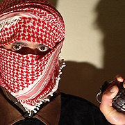 An anti occupation fighter holding a grenade in Rutba, Iraq on the 23rd Dec 2003.