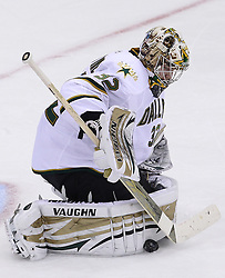 Oct 8; Newark, NJ, USA; Dallas Stars goaltender Kari Lentonen (32) makes a pad save during the third period of their game against the New Jersey Devils at the Prudential Center. The Stars defeated the Devils 4-3 in overtime.