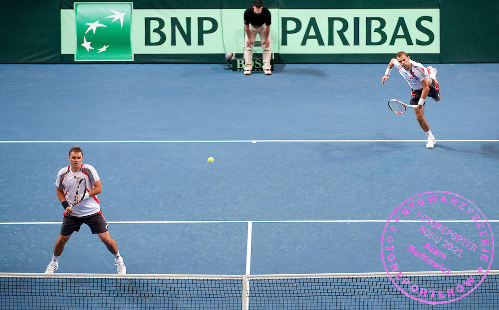 (L) Marcin Matkowski & (R) Mariusz Fyrstenberg both from Poland compete at men's double game during the BNP Paribas Davis Cup 2012 between Poland and Belarus at MOSiR Hall in Lodz on September 15, 2012...Poland, Lodz, September 15, 2012..Picture also available in RAW (NEF) or TIFF format on special request...For editorial use only. Any commercial or promotional use requires permission...Photo by © Adam Nurkiewicz / Mediasport