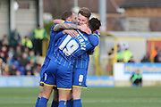 David Fitzpatrick of AFC Wimbledon opens the scoring and celebrates with the team during the Sky Bet League 2 match between AFC Wimbledon and Yeovil Town at the Cherry Red Records Stadium, Kingston, England on 30 January 2016. Photo by Stuart Butcher.
