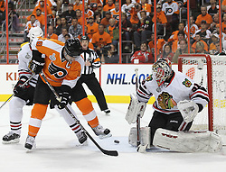 June 9, 2010; Philiadelphia, PA; USA;  Philadelphia Flyers center Mike Richards (18) tips the puck wide of Chicago Blackhawks goalie Antti Niemi (31) during the first period of Game 6 of the Stanley Cup Finals at the Wachovia Center.