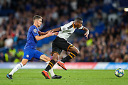 Chelsea midfielder Jorginho (5) pulls back Valencia CF midfielder Geoffrey Kondogbia (6) during the Champions League match between Chelsea and Valencia CF at Stamford Bridge, London, England on 17 September 2019.