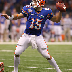 Jan 01, 2010; New Orleans, LA, USA; Florida Gators quarterback Tim Tebow (15) looks to pass against the Florida Gators during the second half of the 2010 Sugar Bowl at the Louisiana Superdome.  Mandatory Credit: Derick E. Hingle-US PRESSWIRE.
