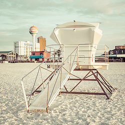 Pensacola Beach Florida lifeguard tower two retro photo with Casino Beach and the beach ball water tower. Pensacola Beach is on Santa Rosa Island in the Emerald Coast area of the Southeastern United States of America. Photo is vertical and high resolution. Copyright ⓒ 2018 Paul Velgos with All Rights Reserved.