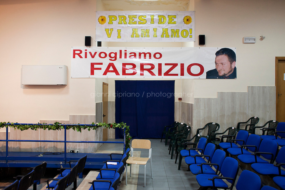 Rosarno, Italy - 31 August, 2012: A banner in the highschool says &quot;We want Fabrizio back&quot;, referring to Fabrizio Pioli, a 38 years old man who was killed in February 2012 and whose body is still missing in  Rosano, Italy, a mafia stronghold on August 31, 2012. Fabrizio Pioli was apparently killed by the family of Simona Napoli, the married woman who Fabrizio had an affair with and whose father is a fugitive mafia boss.<br /> <br /> Rosarno is an agricultural area best known for the violent race riots that erupted here in January 2010. and for being a hotbed of the 'Ndrangheta, a Mafia-type criminal organisation based in Calabria. The local 'Ndrangheta dominates the fruit and vegetable businesses in the area, according to Francesco Forgione, a former head of Italy's parliamentary Antimafia Commission. In December 2008, the entire town council was dissolved on orders from the central government and replaced by a prefectoral commissioner because it had been infiltrated by 'Ndrangheta members and their known associates.<br /> <br /> Calabria is one of the poorest Italian regions which suffers from lack of basic services (hospitals without proper equipment, irregular electricity and water), the product of disparate political interests vying for power. The region is dominated by the 'Ndrangheta (pronounced en-Drang-get-A), which authorities say is the most powerful in Italy because it is the welthiest and best organized.<br /> <br /> The region today has nearly 20 percent unemployment, 40 percent youth unemployment and among the lowest female unemployment and broadband Internet levels in Italy. Business suffer since poor infrastructure drives up transport costs.<br /> <br /> Last summer the European Union's anti-fraud office demanded that Italy redirect 380 million euros in structural funding away from the A3 Salerno - Reggio Calabria highway after finding widespread evidence of corruption in the bidding processes.