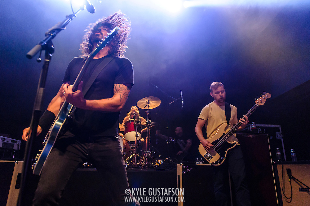 """WASHINGTON, DC - May 5th, 2014 - Dave Grohl, Taylor Hawkins and Nate Mendel of the Foo Fighters perform at the 9:30 Club in Washington D.C. as part of the birthday celebration for Big Tony of Trouble Funk.  The band performed as surprise guests and played a set full of hits such as """"My Hero"""" and """"These Days."""" (Photo by Kyle Gustafson / For The Washington Post)"""