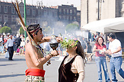 Mexico City-Jan 13: Aztec Medicine Man using smoke and herbs to cleanse the aura of an elderly indigenous woman on 13 Jan in Zocalo, Mexico City Distrito Federal