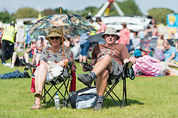 © Licensed to London News Pictures. 13/06/2014. Isle of Wight, UK.  Festival goers relax in the hot afternoon sun at Isle of Wight Festival 2014.   The Isle of Wight festival is an annual music festival that takes place on the Isle of Wight. Photo credit : Richard Isaac/LNP