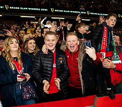 Wales fans celebrate the Grand Slam<br /> <br /> Photographer Simon King/Replay Images<br /> <br /> Six Nations Round 5 - Wales v Ireland - Saturday 16th March 2019 - Principality Stadium - Cardiff<br /> <br /> World Copyright © Replay Images . All rights reserved. info@replayimages.co.uk - http://replayimages.co.uk