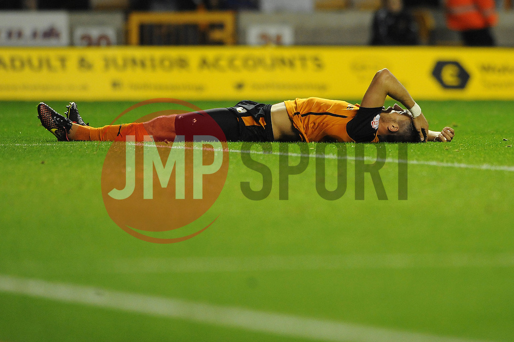 Wolverhampton Wanderers' Danny Batth lies on the floor as Huddersfield Town's Sean Scannell scores the second goal of the game to make it 0 - 2 - Photo mandatory by-line: Dougie Allward/JMP - Mobile: 07966 386802 - 01/10/2014 - SPORT - Football - Wolverhampton - Molineux Stadium - Wolverhampton Wonderers v Huddersfield Town - Sky Bet Championship