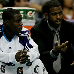 Nov 17, 2009; New Orleans, LA, USA; New Orleans Hornets guard Chris Paul (right) talks to guard Darren Collison (left) on the bench during the first quarter at the New Orleans Arena. Mandatory Credit: Derick E. Hingle-US PRESSWIRE