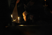 A young boy holds a candle during the Easter Vigil Mass. (Sam Lucero photo)
