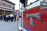 Bellmore, New York, USA. September 11, 2015. A Bellmore fire engine is parked in front of the Bellmore Memorial Ceremony for 3 Bellmore volunteer firefighters and 7 residents who died due to 9/11 terrorist attack at NYC Twin Towers. Bellmore volunteer firefighters Lt. Kevin Prior and F.F. Adam Rand died on 9/11/2001, and F.F. Sean McCarthy died in 2008 due to illness related to working at scene of attack.