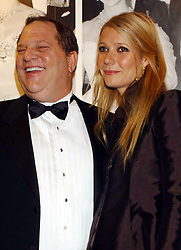 File photo dated 20/10/02 of Harvey Weinstein and Gwyneth Paltrow attending the 50th anniversary gala of the National Film Theatre on the South Bank in London. Paltrow has claimed that she was sexually harassed by Weinstein - one of a string of women to make allegations against him.