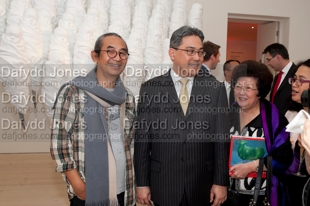 Haris Purnomo; Yuri O Thamrin; Indonesian Ambassador; POPPY HADIMAN, Indonesian Eye Contemporary Art Exhibition Reception, Saatchi Gallery. London. 9 September 2011. <br /> <br />  , -DO NOT ARCHIVE-© Copyright Photograph by Dafydd Jones. 248 Clapham Rd. London SW9 0PZ. Tel 0207 820 0771. www.dafjones.com.