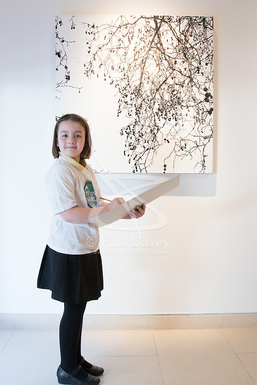 "Christies, St James, London, March 4th 2016. Nine year-old Ashley Hubbard from Charlton Manor Primary School draws Sue Arrowsmith's acrylic on canvas  ""When The Lights Are Low"", 2012, at the preview for the It's Our World charity auction at Christie's. Over 40 leading artists including David Hockney, Sir Antony Gormley, David Nash, Sir Peter Blake, Yinka Shonibare, Sir Quentin Blake, Emily Young and Maggi Hambling have committed artworks to the It's Our World Auction in support of The Big Draw and Jupiter Artland Foundation, to be sold at Christie's London on 10 March 2016.<br />  ///FOR LICENCING CONTACT: paul@pauldaveycreative.co.uk TEL:+44 (0) 7966 016 296 or +44 (0) 20 8969 6875. ©2015 Paul R Davey. All rights reserved."