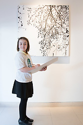 Christies, St James, London, March 4th 2016. Nine year-old Ashley Hubbard from Charlton Manor Primary School draws Sue Arrowsmith's acrylic on canvas  &quot;When The Lights Are Low&quot;, 2012, at the preview for the It&rsquo;s Our World charity auction at Christie's. Over 40 leading artists including David Hockney, Sir Antony Gormley, David Nash, Sir Peter Blake, Yinka Shonibare, Sir Quentin Blake, Emily Young and Maggi Hambling have committed artworks to the It&rsquo;s Our World Auction in support of The Big Draw and Jupiter Artland Foundation, to be sold at Christie&rsquo;s London on 10 March 2016.<br />  ///FOR LICENCING CONTACT: paul@pauldaveycreative.co.uk TEL:+44 (0) 7966 016 296 or +44 (0) 20 8969 6875. &copy;2015 Paul R Davey. All rights reserved.