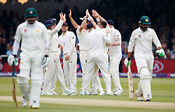 England's players celebrate the wicket of Pakistan's Haris Sohail during day two of the First NatWest Test Series match at Lord's, London.