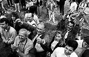 Lega Nord (North League Party) supporters plaude to Senator of Italian Parliament Umberto Bossi, Secretary of Lega Lombarda (Lombard League Party),at a polical rally organized by Lega Nord to celebrate historical Pontida Oath at Pontida, Bergamo, May 20, 1990. © Carlo Cerchioli ..Sostenitori di Umberto Bossi lo applaudono alla festa popolare del Giuramento di Pontida organizzata dalla Lega Lombarda Lega Nord a Pontida, Bergamo, 20 maggio, 1990.