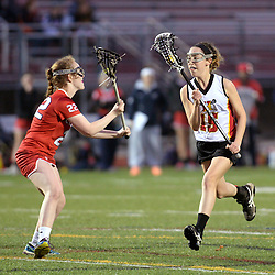 Staff photo by Tom Kelly IV<br /> Haverford's Tess Horan (15) runs with the ball as Plymouth Whitemarsh's Cate Golden (22) plays defense.