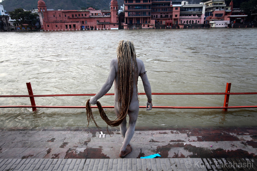A Sadhu (holy man) takes a dip in holy Ganges River in Haridwar, India on Feb 2010 during Kumb Mela, largest Hindu gathering in the world. Hindus believe that bathing in the Ganges during the festival cleanses them of sin. Photo by Kuni Takahashi.