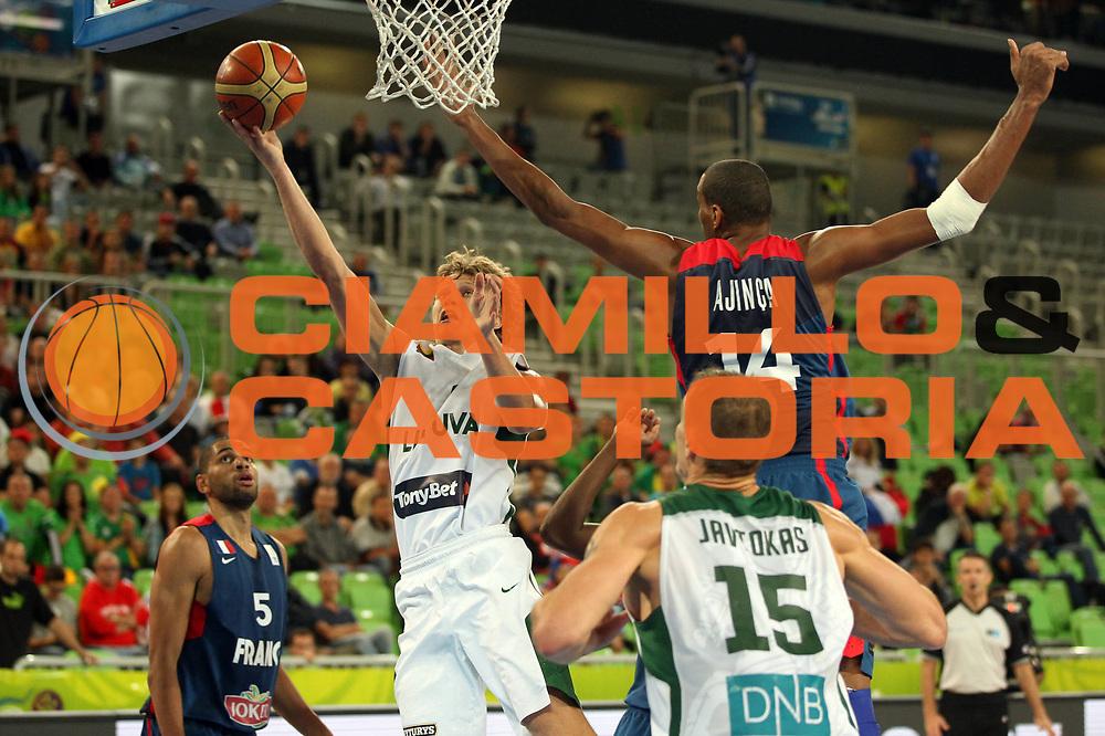 DESCRIZIONE : Lubiana Ljubliana Slovenia Eurobasket Men 2013 Second Round Lituania Francia Lithuania France<br /> GIOCATORE : Mindaugas Kuzminskas <br /> CATEGORIA : tiro shot<br /> SQUADRA : Lituania Lithuania<br /> EVENTO : Eurobasket Men 2013<br /> GARA : Lituania Francia Lithuania France<br /> DATA : 11/09/2013 <br /> SPORT : Pallacanestro <br /> AUTORE : Agenzia Ciamillo-Castoria/M.Metlas<br /> Galleria : Eurobasket Men 2013<br /> Fotonotizia : Lubiana Ljubliana Slovenia Eurobasket Men 2013 Second Round Lituania Francia Lithuania France<br /> Predefinita :