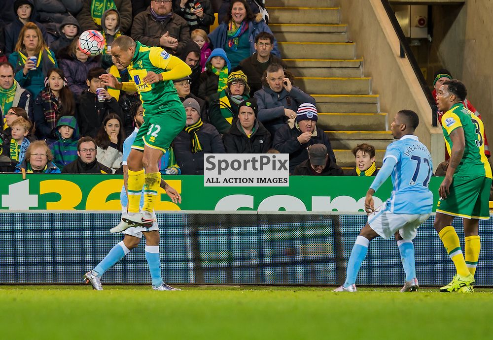 Norwich City midfielder Vadis Odjidja-Ofoe (32) rises high to head clear