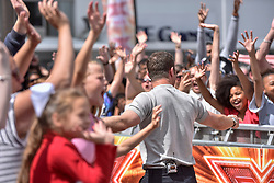 "© Licensed to London News Pictures. 21/07/2017. London, UK.  TV show host Dermot O'Leary greets fans outside Wembley Arena ahead of ""X Factor Bootcamp"".   Photo credit : Stephen Chung/LNP"
