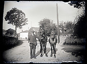 farmer standing with two horses France circa 1920s