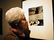 Ruth Pitman with the photograph of her ear,' East Sussex coast 1957' Bill Brandt exhibition exhibition opening, V. & A. 22 March 2004. ONE TIME USE ONLY - DO NOT ARCHIVE  © Copyright Photograph by Dafydd Jones 66 Stockwell Park Rd. London SW9 0DA Tel 020 7733 0108 www.dafjones.com