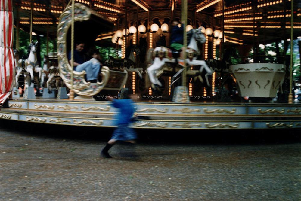 Milan, Lorenteggio. Horses Merry-go round at a children' party