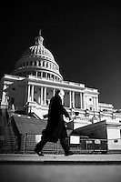 A man walks by the US Capitol Building in Washington, DC on January 26, 2006.