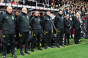 Manchester United manager Ole Gunnar Solskjaer stands for a minutes silence with his coaching team during the Premier League match between Bournemouth and Manchester United at the Vitality Stadium, Bournemouth, England on 2 November 2019.
