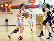 LANGHORNE, PA -  JANUARY 10:  Neshaminy's Madison Murray #33 dribbles towards the net as Council Rock North's Hailey Burns #41 defends during a basketball game at Neshaminy high school January 10, 2014 in Langhorne, Pennsylvania. (Photo by William Thomas Cain/Cain Images)