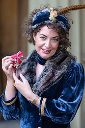 Poet Katharine Clanchy poses with her MBE for services to literature, awarded at an investiture by HRH The Prince of Wales at Buckingham Palace in London. London, February 07 2019.