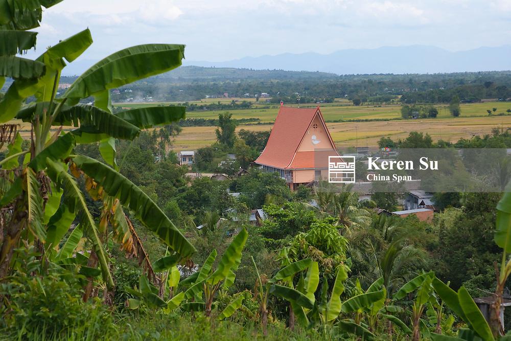 Small hut and farmland.