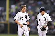 CHICAGO - JUNE 09:  Gordon Beckham #15 enjoys a laugh with third base coach Jeff Cox #8 of the Chicago White Sox after Beckham connected for his first major league hit off of Dontrelle Willis #21 of the Detroit Tigers in the second inning on June 9, 2009 at U.S. Cellular Field in Chicago, Illinois.  (Photo by Ron Vesely)