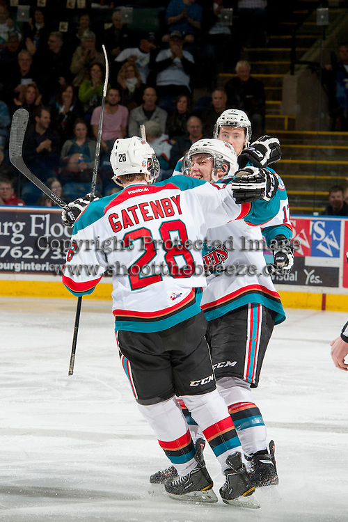 KELOWNA, CANADA - MARCH 23: Joe Gatenby #28 and Rourke Chartier #14 of the Kelowna Rockets celebrate Gatenby's first WHL goal against the Tri-City Americans on March 23, 2014 at Prospera Place in Kelowna, British Columbia, Canada.   (Photo by Marissa Baecker/Shoot the Breeze)  *** Local Caption *** Joe Gatenby; Rourke Chartier;