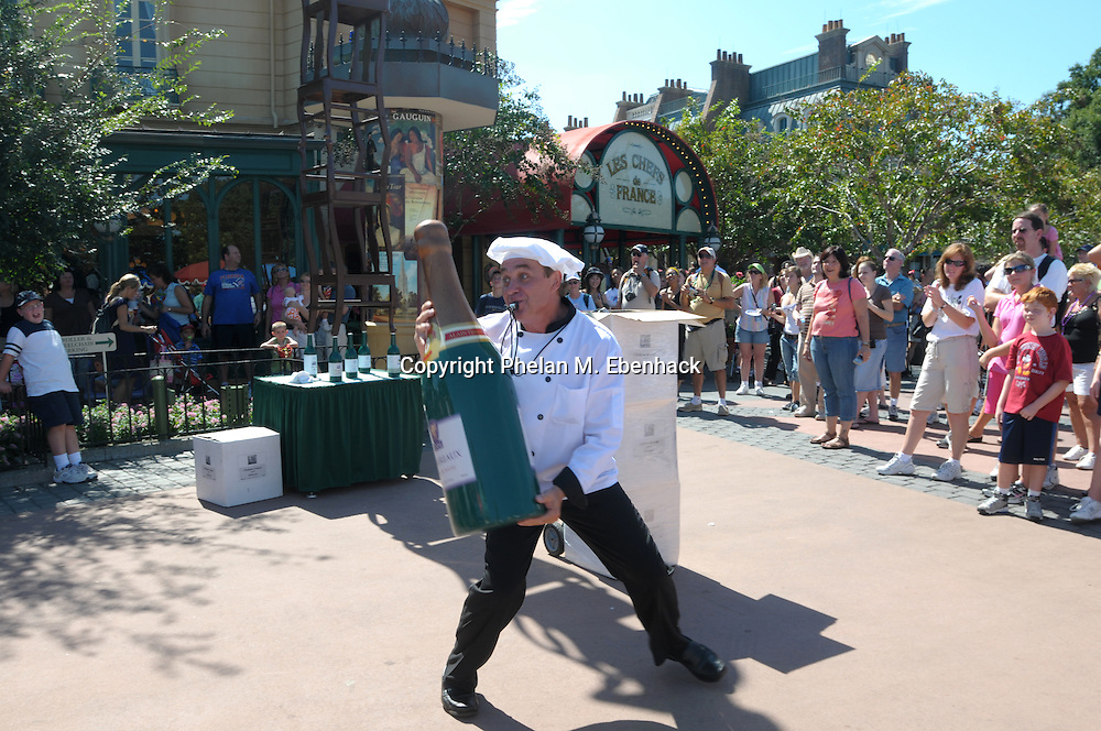 A street performer entertains the crowd at the France Pavillion in the World Showcase section of Walt Disney World's EPCOT theme park in Lake Buena Vista, Florida, Saturday, Sept. 27, 2008.