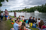 Henley Royal Regatta, 3-7 July 2019. General View, GV, Spectators, with picnics, on the tow path, Royal Henley Peace Regatta Centenary, 1919-2019. Henley on Thames.<br /> <br /> <br /> <br /> [Mandatory Credit: Patrick WHITE/Intersport Images], 6, 06/07/2019,  11:26:13