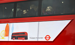 © Licensed to London News Pictures. 16/12/2011, London, UK. School children look out of the top floor of the double decker bus.  The first bus designed specifically for London arrived in the capital today, carrying the Mayor of London BORIS JOHNSON. The bus design is based on the famous red route master buses with a rear platform for access. Photo credit : Stephen Simpson/LNP