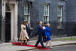 London, UK. 4 June, 2019. US President Donald Trump and Prime Minister Theresa May, followed by First Lady Melania Trump and Philip May, leave 10 Downing Street for more bilateral talks in the Foreign and Commonwealth Office on the second day of his state visit to the UK.