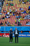 England manager Roy Hodgson (right) with assistant Ray Lewington take a stroll on the pitch prior to the 2014 FIFA World Cup match at Arena da Amazonia, Manaus<br /> Picture by Andrew Tobin/Focus Images Ltd +44 7710 761829<br /> 14/06/2014