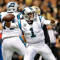 Dec 7, 2014; New Orleans, LA, USA; Carolina Panthers quarterback Cam Newton (1) against the New Orleans Saints during the first half of a game at the Mercedes-Benz Superdome. The Panthers defeated the Saints 41-10. Mandatory Credit: Derick E. Hingle-USA TODAY Sports