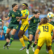 GRENOBLE, FRANCE June 18.  Sam Kerr #20 of Australia has goalwards while defend by Khadija Shaw #11 of Jamaica during the Jamaica V Australia, Group C match at the FIFA Women's World Cup at Stade des Alpes on June 18th 2019 in Grenoble, France. (Photo by Tim Clayton/Corbis via Getty Images)
