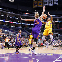 24 August 2014: Los Angeles Sparks guard Lindsey Harding (10) takes a jump shot over Phoenix Mercury guard Erin Phillips (31) during the Phoenix Mercury 93-68 victory over the Los Angeles Sparks, in a Conference Semi-Finals at the Staples Center, Los Angeles, California, USA.